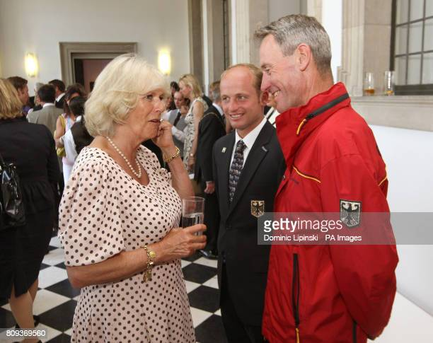 The Duchess of Cornwall meets German rider Michael Jung and Germany Coach Chris Bartle at a reception for competitors owners and sponsors at the...