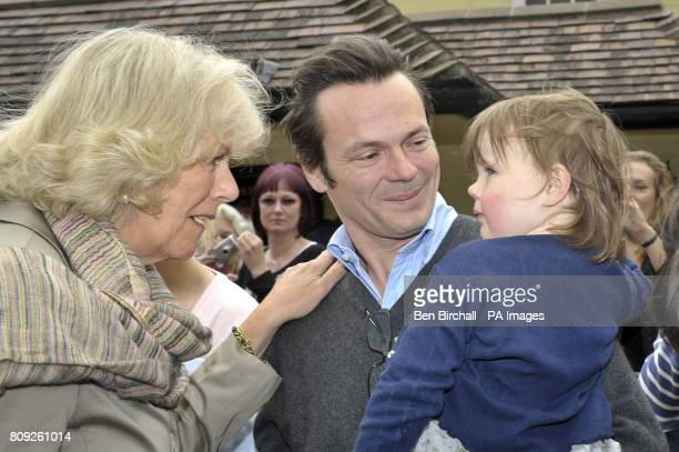 The Duchess of Cornwall meets her great niece Violet and nephewinlaw Luke Irwin at the White Horse pub in Blandford Forum Dorset