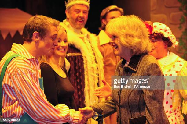 The Duchess of Cornwall meets Jon Monie who plays Simple Simon in the pantomime Jack and the Beanstalk during a visit to the Theatre Royal in Bath