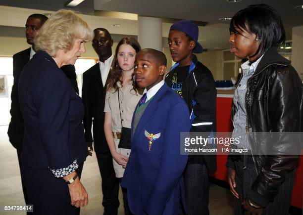 The Duchess of Cornwall meets members and young riders at the Ebony Horse Club in Brixton London including from left rider and youth worker Arron...