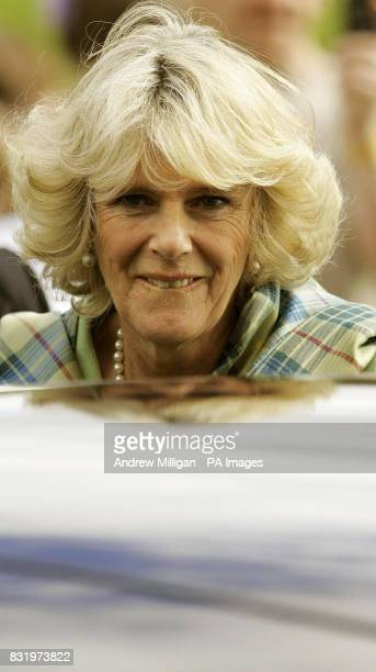 The Duchess of Cornwall observes how a Prince's Trust project is improving the local environment at Niddrie Burn in the Craigmillar area of Edinburgh
