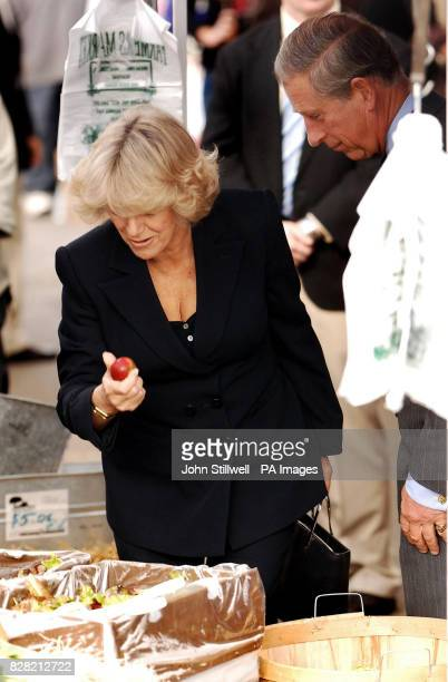 The Duchess Of Cornwall picks up an apple watched by her husband the Prince of Wales at the Farmer's Market in Port Reyes Califoria Saturday 5th...