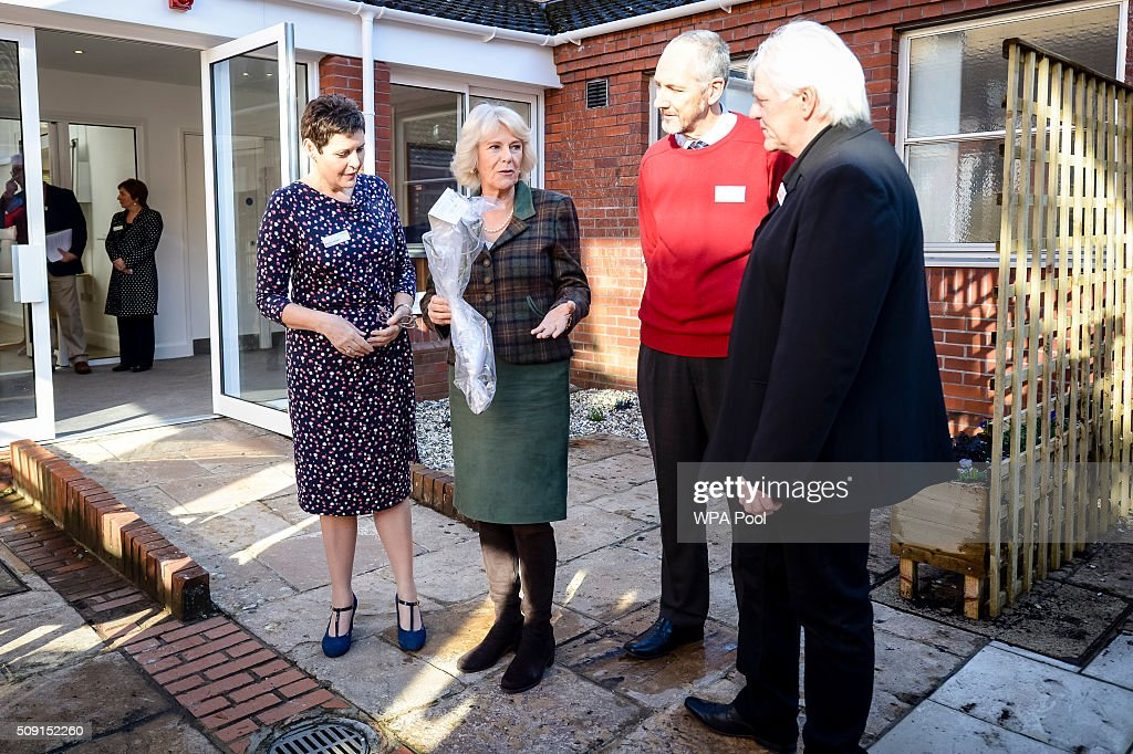 The Duchess of Cornwall presents a rose to volunteers and staff Nick Knell (second right), Steve Nethercot, (right), while being shown around by Chief Executive Angela Jordan (left) during a visit to Prospect Hospice's new facility at Savernake Hospital which gives care and support to patients, carers and families dealing with terminal illness on February 9, 2016 in Marlborough, England.