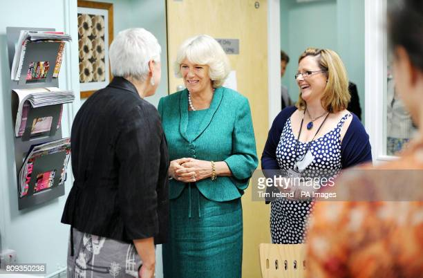 The Duchess of Cornwall speaks with staff at Ynys Saff Cardiff and Vale Sexual Assault Referral Centre accompanied by SARC manager Jeanie Roderick...