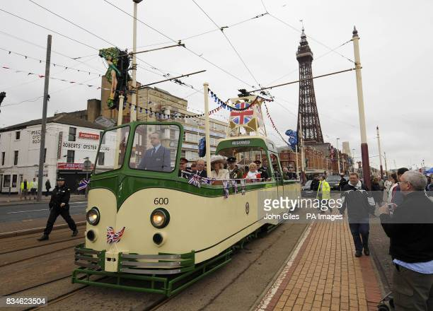 The Duchess of Cornwall travels on a tram through Blackpool today as she attends the National Veterans Day in Blackpool