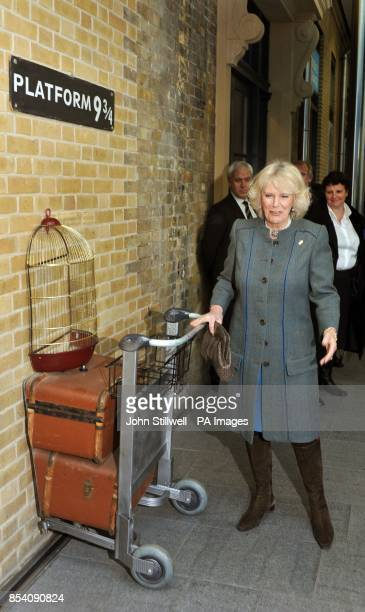 The Duchess of Cornwall tries to board the Harry Potter inspired Hogwarts Express at the fictional Platform of 9 and three quaters during a tour with...