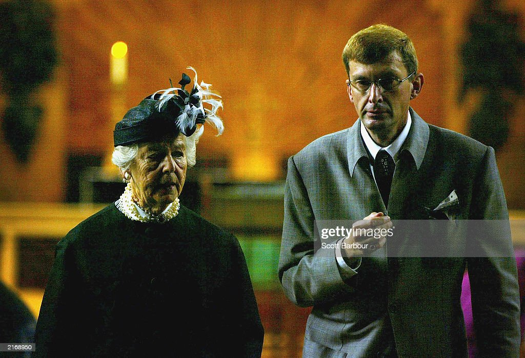 The Duchess of Devonshire (L) and David Freeman enter St. James's Church as they arrive at the Service of Thanksgiving to Celebrate the Life and Work of Sir Hardy Amies July 17, 2003 in London. The memorial service was held for Hardy who was the Queen's dressmaker since 1951. Among his other clients were Diana, Princess of Wales, Vivien Leigh and Lady Diana Cooper, but it is for his royal designs that he is best remembered. He had been retired for only a matter of months before his death, aged 93 in March 2003.