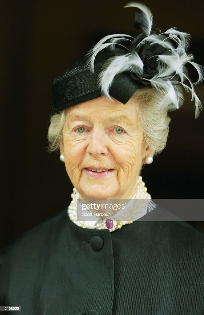 The Duchess of Devonshire poses for photographers as she arrives at the Service of Thanksgiving to Celebrate the Life and Work of Sir Hardy Amies July 17, 2003 in London. The memorial service was held for Hardy who was the Queen's dressmaker since 1951. Among his other clients were Diana, Princess of Wales, Vivien Leigh and Lady Diana Cooper, but it is for his royal designs that he is best remembered. He had been retired for only a matter of months before his death, aged 93 in March 2003.