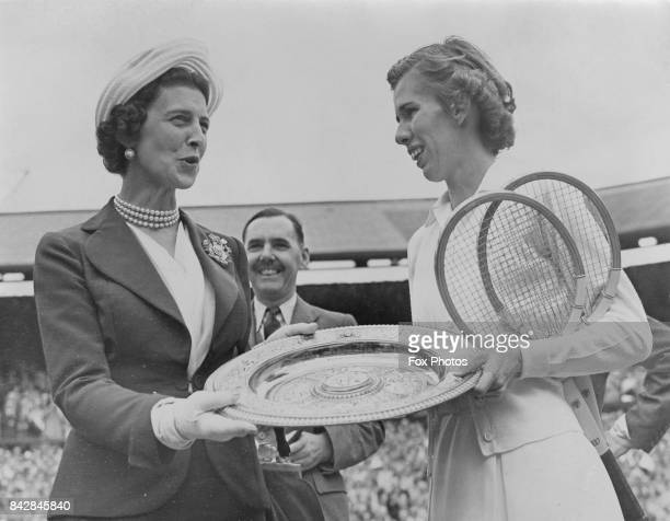 The Duchess of Kent presents American tennis player Doris Hart with the Women's Singles trophy after she beat Shirley Fry in the final at Wimbledon...