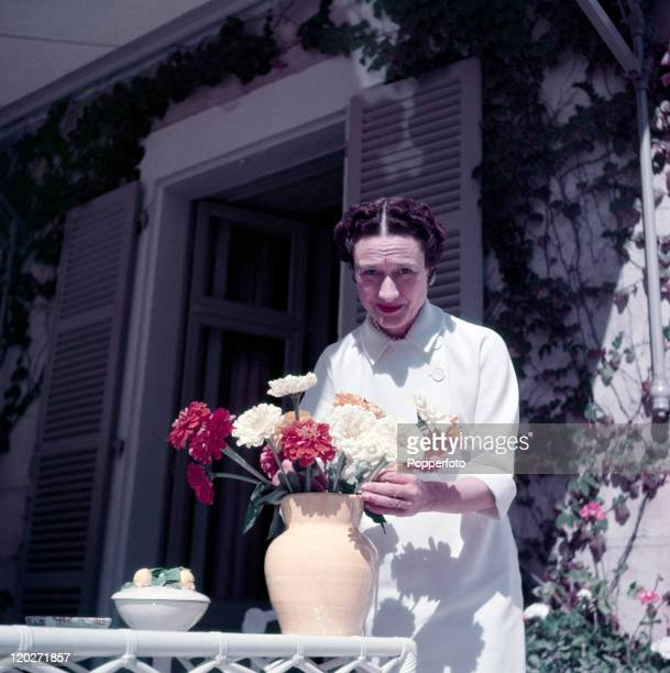 The Duchess of Windsor arranging flowers on the terrace of a villa in Biarritz circa October 1951