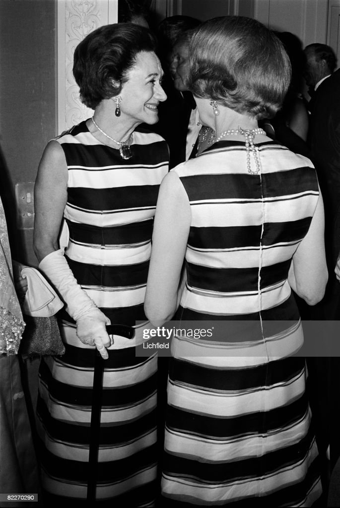 The Duchess of Windsor talking to Aileen Plunket at a party in Paris given by Princess Charles d'Arenberg, they are both wearing a Givenchy striped dress, on 13th June 1966. (Photo by Lichfield/Getty Images).