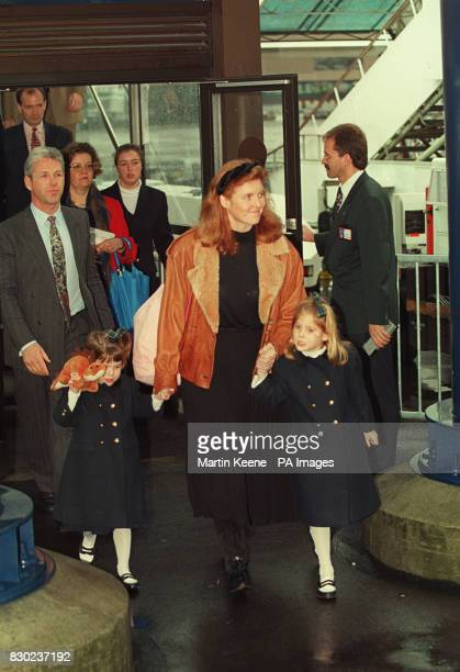 The Duchess of York Sarah Ferguson with her daughters Princess Eugenie and Beatrice as they arrive at Zurich airport en route for the Swiss resort of...