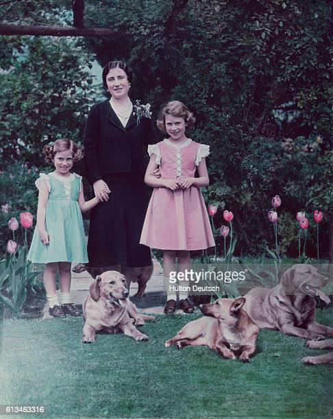 The Duchess of York with her daughters Princess Elizabeth and Princess Margaret in the garden of the Royal Lodge at Windsor
