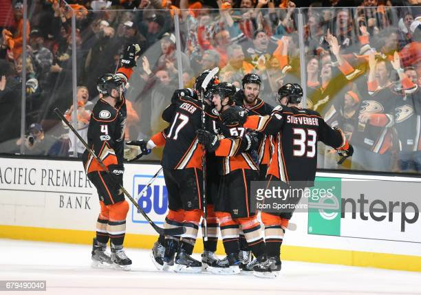 The Ducks celebrate scoring their third goal to tie the game with 15 seconds left on the clock in the third period during game 5 of the second round...