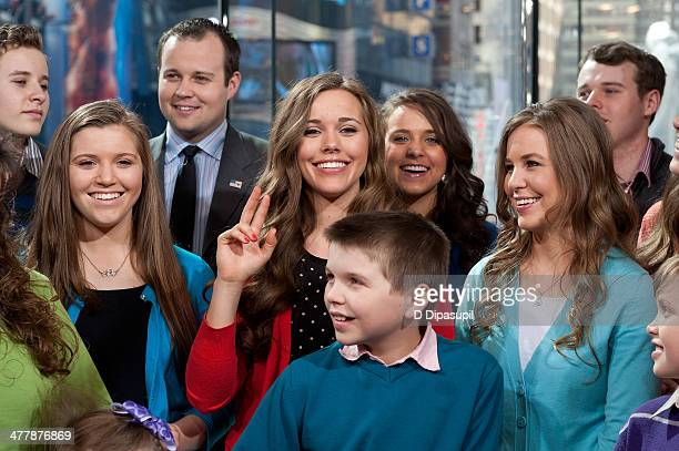 The Duggar family visits 'Extra' at their New York studios at HM in Times Square on March 11 2014 in New York City