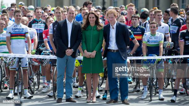 The Duke and Duchess of Cambridge along with Prince Harry pose for a picture in front of the peloton at Harewood House Leeds Yorkshire
