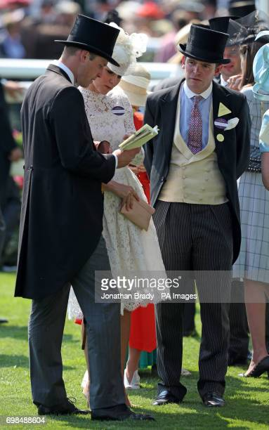 The Duke and Duchess of Cambridge and James Meades in the Parade Ring before the start of the Kings Stand Stakes during day one of Royal Ascot at...