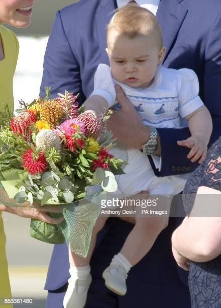 The Duke and Duchess of Cambridge and Prince George arrive at Sydney Kingsford Smith Airport on a Royal Australian Air Force aircraft during the...