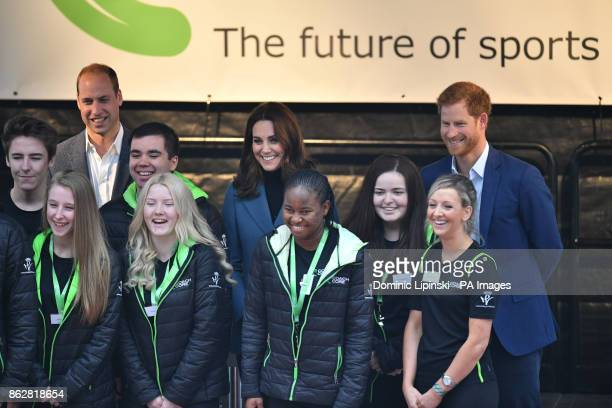 The Duke and Duchess of Cambridge and Prince Harry stand with some of the 150 Coach Core apprentices as they attend their graduation ceremony at West...
