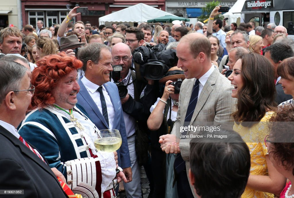 The Duke and Duchess of Cambridge and the Mayor of Heidelberg (third left) tour a traditional German market in the central square of Heidelberg, Germany.