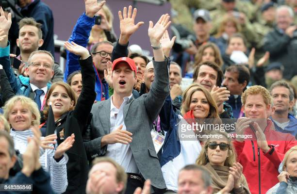 The Duke and Duchess of Cambridge cheer and wave as Great Britain's Eventing team arrive to collect their medals during the Individual Eventing...