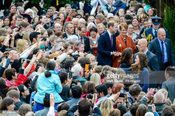 The Duke and Duchess of Cambridge meet wellwishers in the crowd during their walkabout in Civic Square Wellington New Zealand during their threeweek...