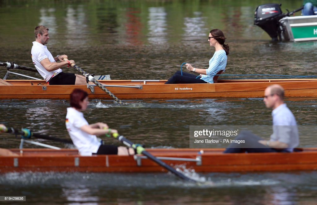 The Duke and Duchess of Cambridge take part in a rowing competition on the River Neckar during their visit to Heidelberg on the second day of their three-day tour of Germany.