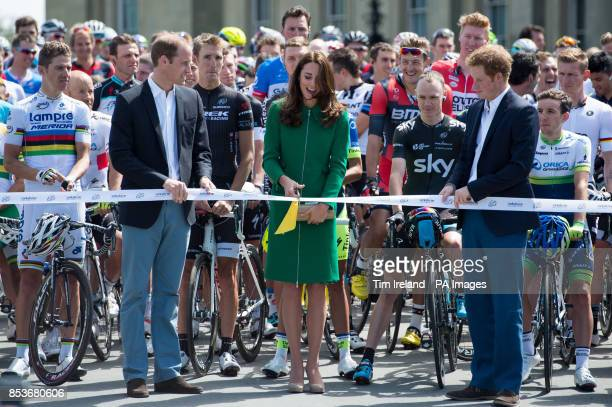 The Duke and Duchess of Cambridge with Prince Harry cut the ribbon in front of the Peloton at Harewood House Leeds Yorkshire