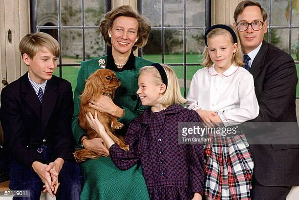 The Duke And Duchess Of Gloucester With Their Children L To R Earl Of Ulster Lady Davina Windsor And Lady Rose Windsor And The Family Dog At Their...