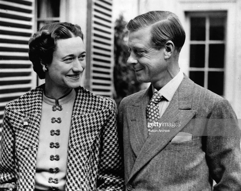 The Duke (1894 - 1972) and Duchess (1896 - 1986) of Windsor in England after an absence of nearly three years, in the garden of Major Edward Dudley Metcalfe's country house, Coleman's Hatch, Ashdown Forest, Sussex.