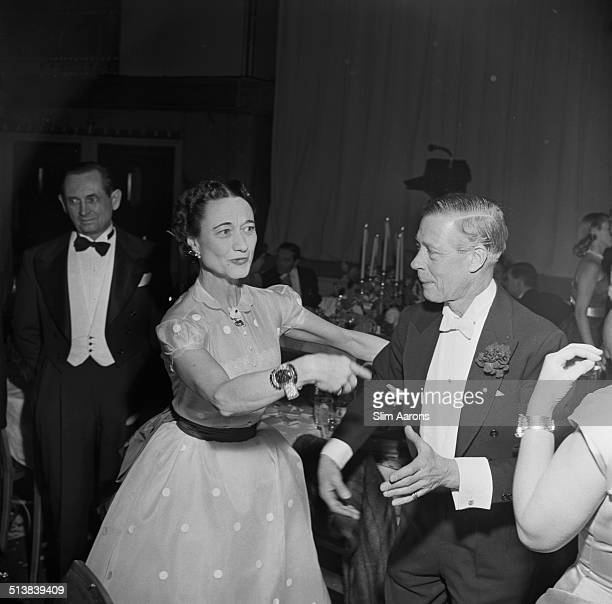 The Duke and Duchess of Windsor talk to guests at a party being held in their honour at the Waldorf Astoria Park Avenue New York 1953
