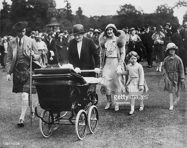 The Duke and Duchess of York later Queen Elizabeth and King George VI attend a garden party at Glamis Castle in Angus Scotland to celebrate the...