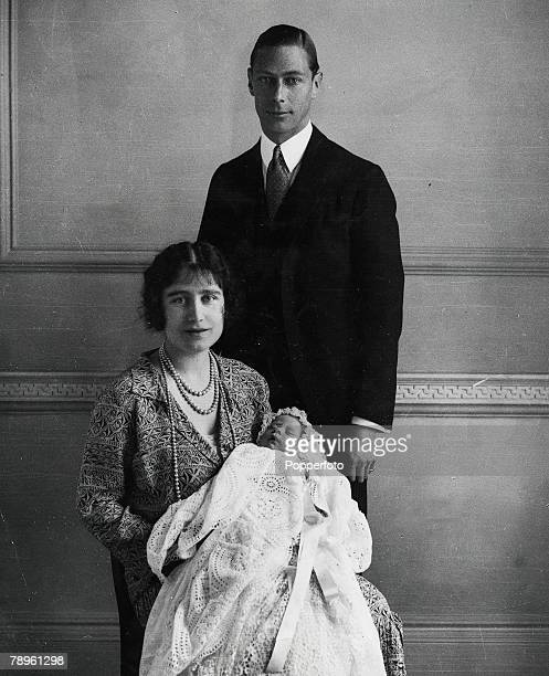 1926 The Duke and Duchess of York pictured with their daughter as she sleeps in a precious christening robe which has been used in the Royal Family...