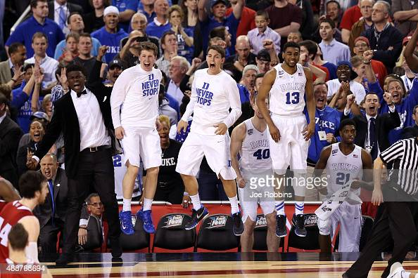 The Duke Blue Devils bench celebrates late in the game against the Wisconsin Badgers during the NCAA Men's Final Four National Championship at Lucas...