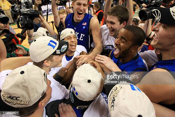 The Duke Blue Devils celebrate after their 7558 victory over the North Carolina Tar Heels to win the championship game of the 2011 ACC men's...