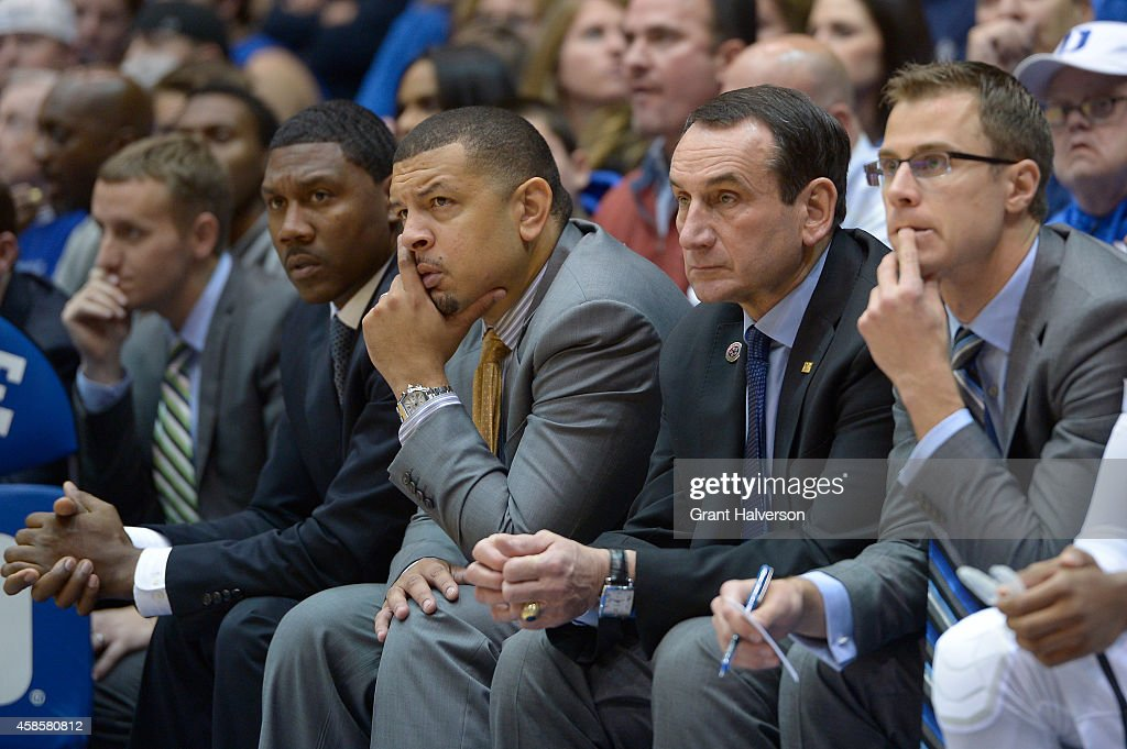 The Duke Blue Devils coaching staff of (L-R) Nate James, Jeff Capel, head coach <a gi-track='captionPersonalityLinkClicked' href=/galleries/search?phrase=Mike+Krzyzewski&family=editorial&specificpeople=213322 ng-click='$event.stopPropagation()'>Mike Krzyzewski</a> and <a gi-track='captionPersonalityLinkClicked' href=/galleries/search?phrase=Jon+Scheyer&family=editorial&specificpeople=3847405 ng-click='$event.stopPropagation()'>Jon Scheyer</a> watch during their game against the Livingstone College Blue Bears at Cameron Indoor Stadium on November 4, 2014 in Durham, North Carolina. Duke won 115-58.