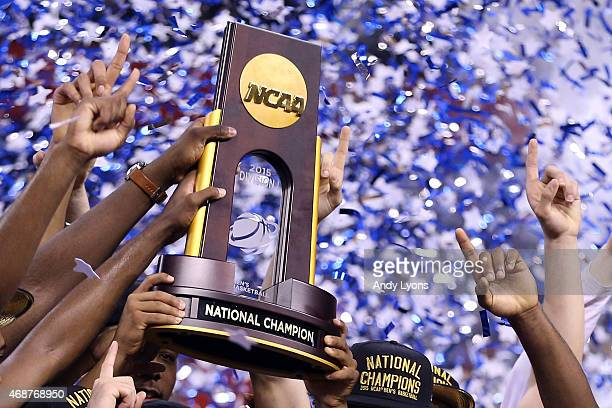 The Duke Blue Devils hold up the championship trophy after defeating the Wisconsin Badgers during the NCAA Men's Final Four National Championship at...