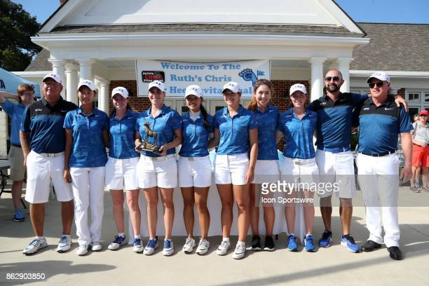 The Duke Blue Devils pose with their trophy for winning the tournament during the third and final round of the Ruth's Chris Tar Heel Invitational...