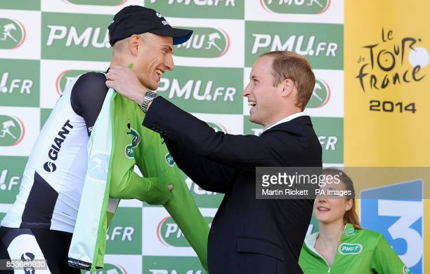 The Duke Cambridge presents the green points jersey to Marcel Kittel of GiantShimano after winning stage one of the Tour de France in Harrogate...