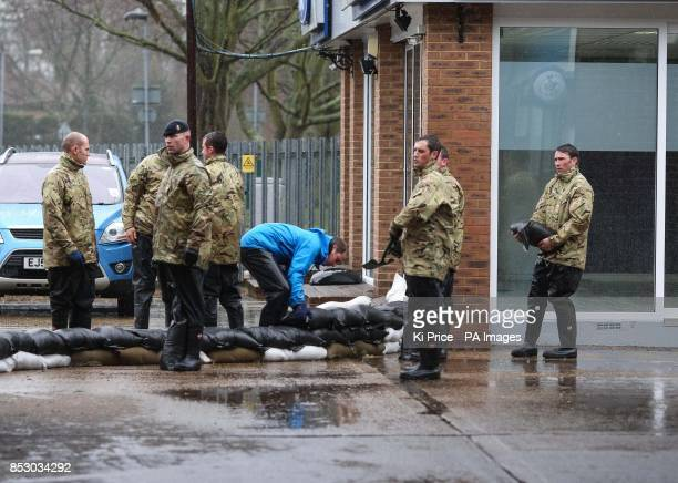 The Duke of Cambridge carrying sandbags in Datchet Berkshire as he and his brother Prince Harry joined colleagues from the armed forces in helping to...