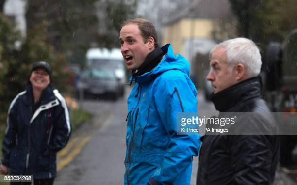 The Duke of Cambridge in Datchet Berkshire as he and his brother Prince Harry joined colleagues from the armed forces in helping to defend the town...