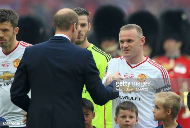 The Duke of Cambridge meets Manchester United's Wayne Rooney prior to the match