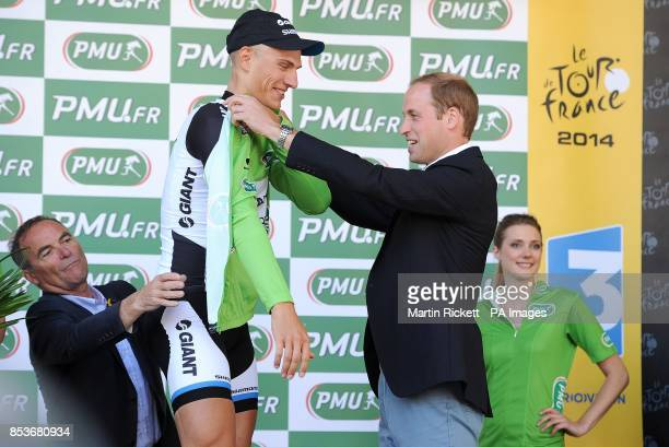 The Duke of Cambridge presents the green points jersey to Marcel Kittel of GiantShimano after winning stage one of the Tour de France in Harrogate...