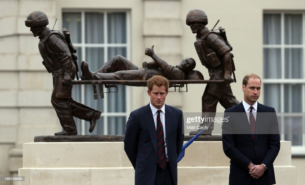The Duke of Cambridge, Prince William and <a gi-track='captionPersonalityLinkClicked' href=/galleries/search?phrase=Prince+Harry&family=editorial&specificpeople=178173 ng-click='$event.stopPropagation()'>Prince Harry</a> stand in front of the Help for Heroes statue as they officially open the charity's Tedworth House recovery centre on May 20, 2013 in Tidworth, England. During their visit the two Royal Princes met with wounded veterans, serving personnel, and their families. Tedworth House in Wiltshire is one of four new units in England which will offer respite care and rehabilitation to injured and sick service personnel, veterans and their families.
