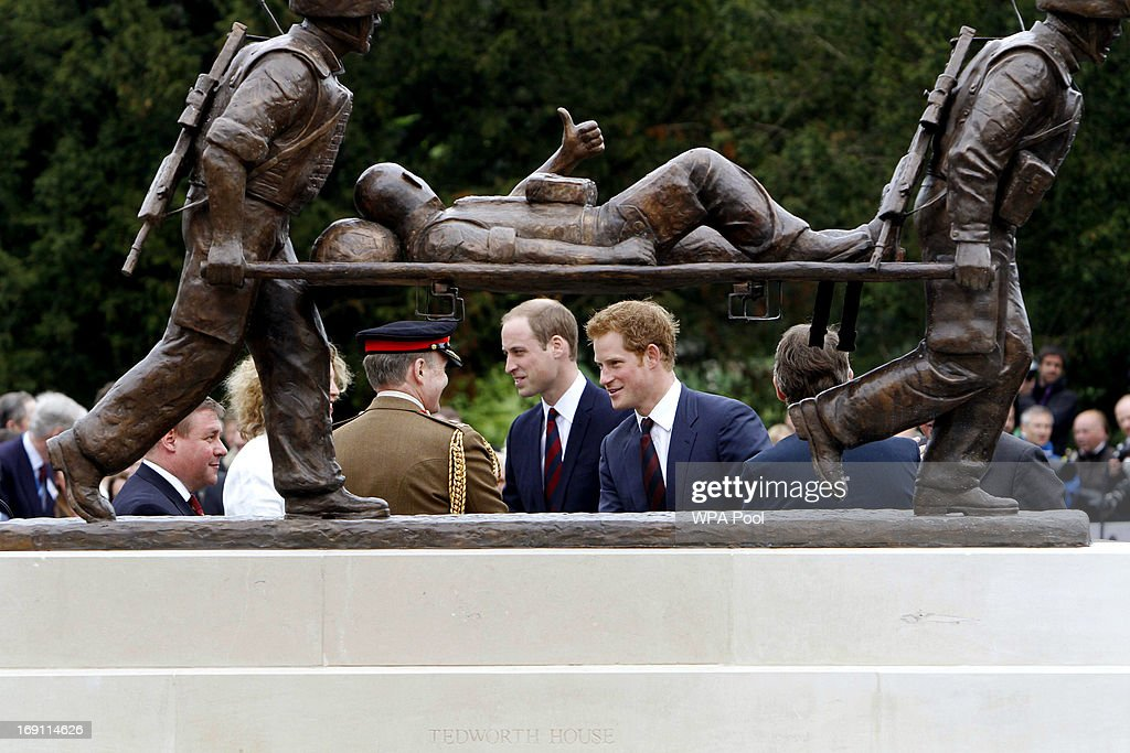 The Duke of Cambridge, Prince William (L) and <a gi-track='captionPersonalityLinkClicked' href=/galleries/search?phrase=Prince+Harry&family=editorial&specificpeople=178173 ng-click='$event.stopPropagation()'>Prince Harry</a> stand infront of Help for Heroes statue during their visit to Tedworth House to officially open the charity's Tedworth House recovery centre on May 20, 2013 in Tidworth, England. During their visit the two Royal Princes met with wounded veterans, serving personnel, and their families. Tedworth House in Wiltshire is one of four new units in England which will offer respite care and rehabilitation to injured and sick service personnel, veterans and their families.