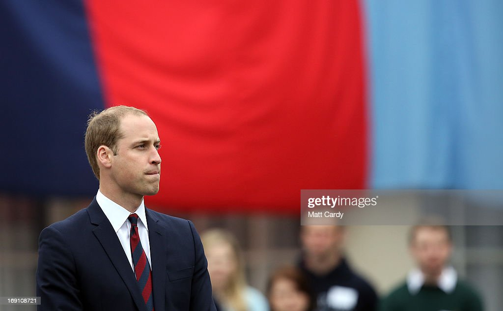 The Duke of Cambridge, Prince William speaks in front of a Help for Heroes flag as he officially opens the charity's Tedworth House recovery centre on May 20, 2013 in Tidworth, England. During their visit the two Royal Princes met with wounded veterans, serving personnel, and their families. Tedworth House in Wiltshire is one of four new units in England which will offer respite care and rehabilitation to injured and sick service personnel, veterans and their families.
