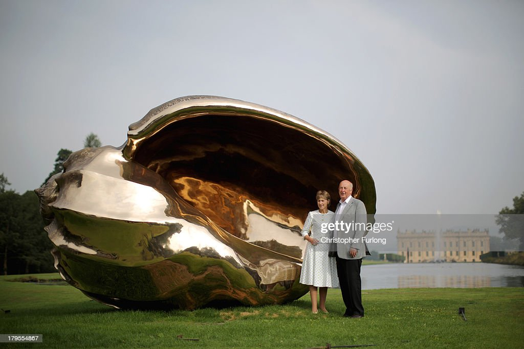 The Duke of Devonshire and Duchess of Devonshire view a piece of art titled 'Spiral of the Galaxy' is displayed in the grounds of Chatsworth House as part of the Sotheby's Beyond Limit's sculpture exhibition on September 5, 2013 in Chatsworth, England. World renowned artists such as Jaume Plensa, Marc Quinn, Manolo Valdes and Thomas Heatherwick feature in the show in the grounds of stately Chatsworth House in the Peak District. The 20 works will be on view to the public from 9 September to 21 October.