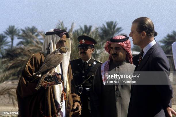 The Duke of Edinburgh an experienced falconer looking at one of the falcons while chatting to handler Ali bin Hassan AlMajid Almaimi during his visit...