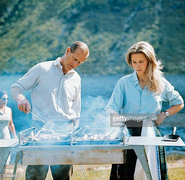 HRH The Duke of Edinburgh and HRH The Princess Anne preparing a barbecue on the Estate at Balmoral Castle Scotland during the Royal Family's annual...