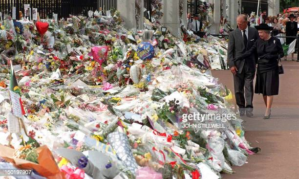 The Duke of Edinburgh and Queen Elizabeth view the thousands of flowers and tributes left outside Kensington Palace in memory of Diana Princess of...